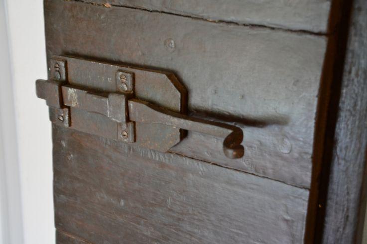 rustic lock on the old original wooden door...