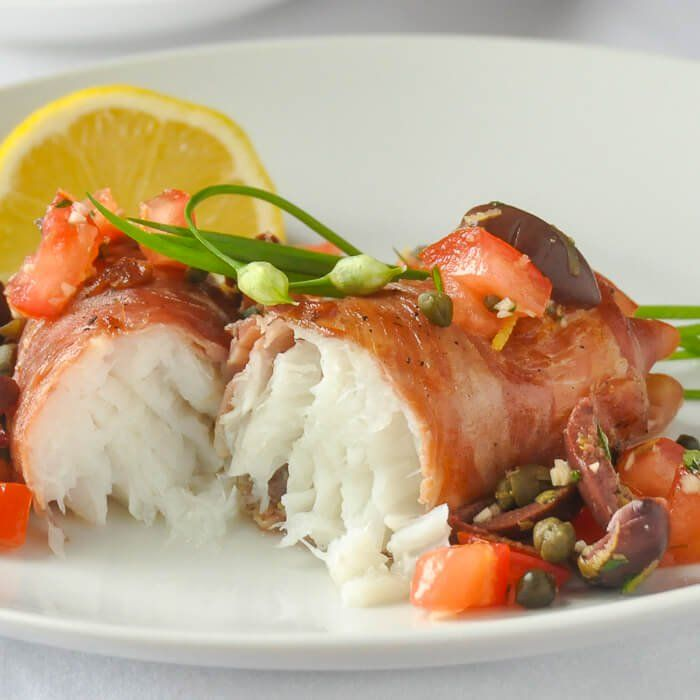 Prosciutto Wrapped Cod with Mediterranean Salsa - beautiful fresh north Atlantic cod wrapped in prosciutto and served with a Mediterranean inspired salsa.