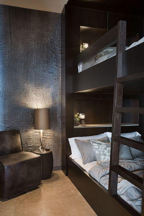 Masculine interior design bedroom Lower Foxtail residence, Big Sky, MT. Teton Heritage Builders.