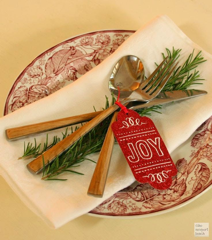Simple Christmas table place setting with fresh rosemary and a glittery gift tag.  #tablescape #holiday