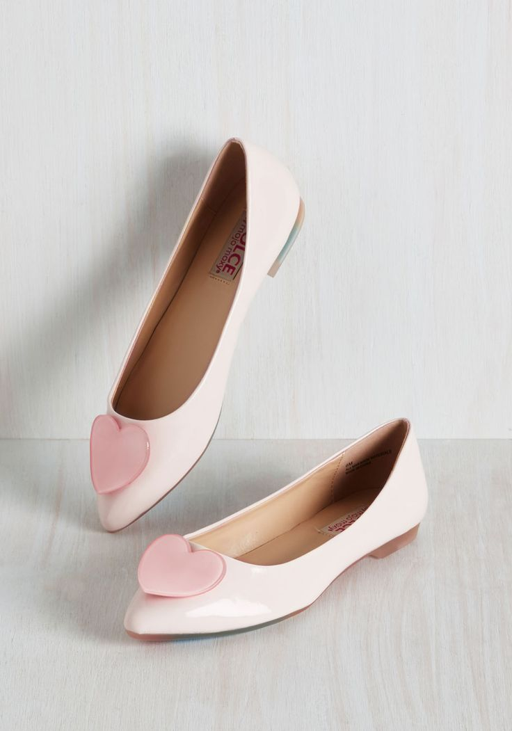 Flaunt your enthusiasm for amour by strolling through the neighborhood, spreading cheer in these pink flats by Mojo Moxy. Shining with patent, vegan faux-leather and flaunting heart appliques atop their pointed toes, this pair is sweet as can be. What's not to love?