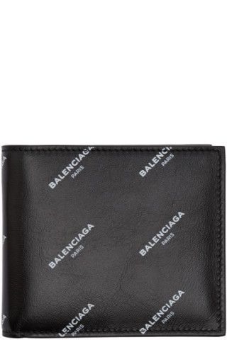 Grained leather bifold wallet in black. Logo pattern printed in white throughout. Card and note slots at tonal grained leather interior. Tonal textile lining. Tonal stitching. Approx. 4.5 length x 3.75 height.