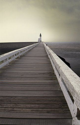 Beautiful inspirational photography - jetty with lighthouse (source: http://malinconialeggera.tumblr.com)