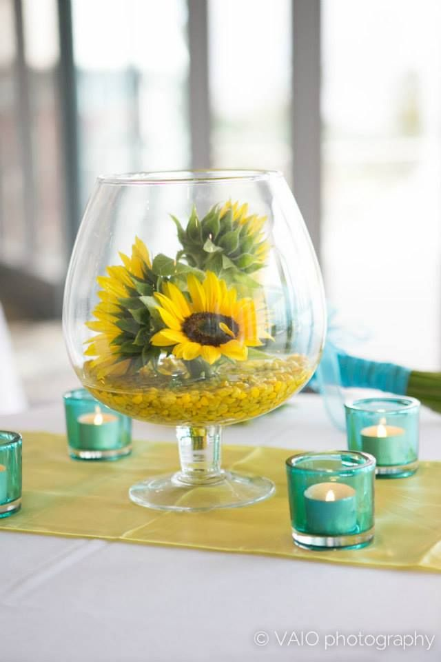 Sunflowers...table flowers...candles...yellow and blue theme...viao photography