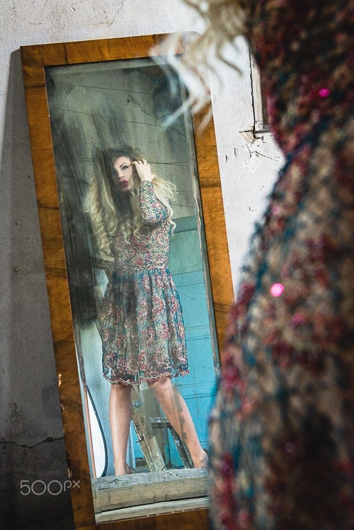 Mirror mirror on the wall - Model Catalina looking in the mirror at photoshoot
