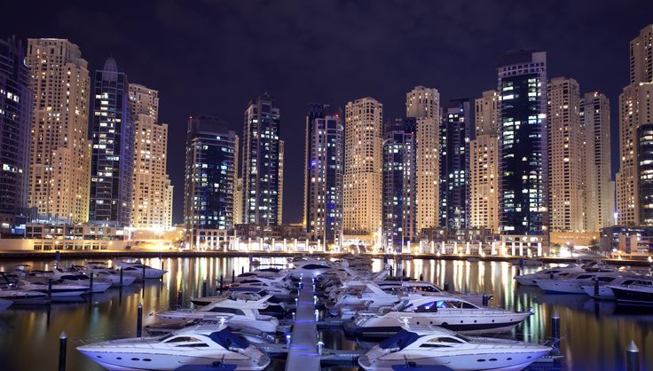 Dubai Marina is a district in Dubai, United Arab Emirates. Dubai Marina is an artificial canal city, built along a two mile (3 km) stretch of Persian Gulf shoreline. It is located on Interchange 5 between Jebel Ali Port and the area which hosts Dubai Internet City, Dubai Media City, and the American University in Dubai.  Dubai Marina was inspired by the Concord Pacific Place development along False Creek in Vancouver, BC, Canada.