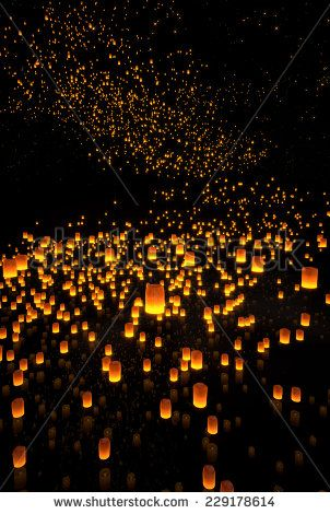 beautiful Lanterns flying on the water and in the night sky