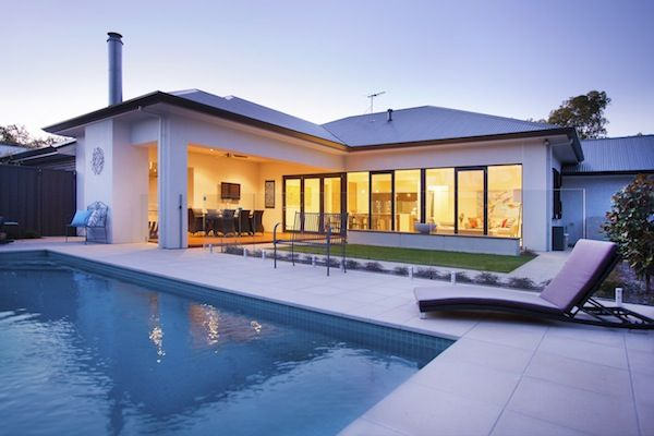The outdoor entertaining area is complemented by the gorgeous pool.