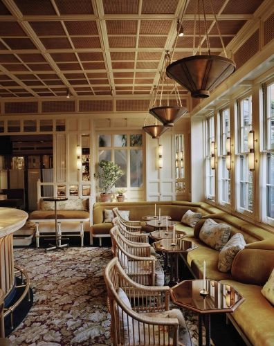 Chiltern Firehouse Bar. Old style with modern twist. Cane furniture, panelled ceiling, vertical regency panelled walls, flower patterned carpet