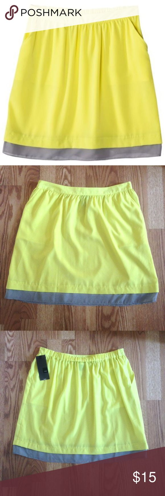 "NWT Mossimo Neon Yellow Skirt w/ pockets NWT Neon Yellow Skirt with grey chiffon trim from Mossimo. Size: L. Color: Neon Yellow and grey. Elastic waist, pockets, 100% polyester, length of yellow fabric approx 17.5"", total length approx 18.5"". Mossimo Supply Co Skirts"