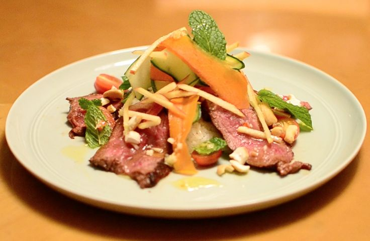 ASIAN BEEF SALAD – A HEALTHY SWEET AND SPICY MEAL!   This Asian Beef Salad is an exciting dish full of life, with fresh vegetables and a zesty flavoured dressing! You can use any vegetables in your kitchen! Seriously. This dish is a great way to use up any leftover greens in your fridge that you've gathered over the week.
