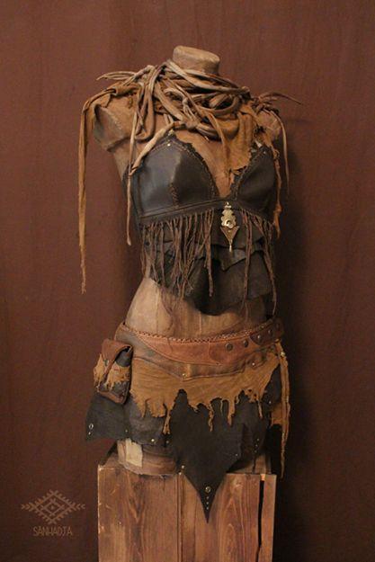 Thea ancient dancer! High priestess, sensual, leather, metal, leather strip around neck, snakelike, interesting, chaotic, organic