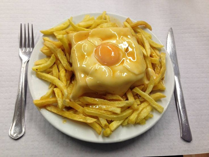 - the famous Francesinha at Cafe Santiago in Porto. That's a triple decker steak and sausage and mortadella and ham and cheese sandwich. Wrapped in a fried egg. With chips and gravy