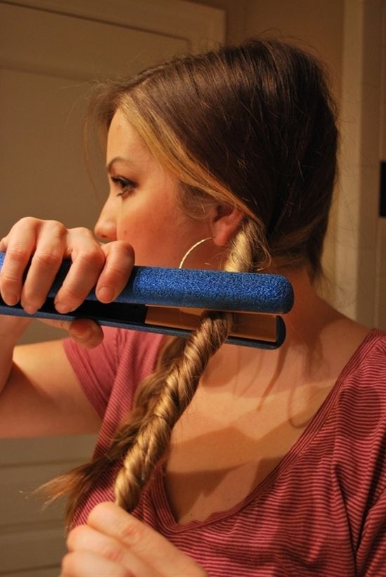 Totally trying this! Split and braid your hair into two sections and tie with a rubberband. Twist the braid away from your face and then twist the flat iron onto your hair in the same direction your hair is twisted. Do not touch rubberband or else you will get that weird crease. Repeat this process twice! After hair is cooled, then take them out and run your fingers through the braid. Saw this on Rachel Ray Show. It gives you nice beachy waves! -
