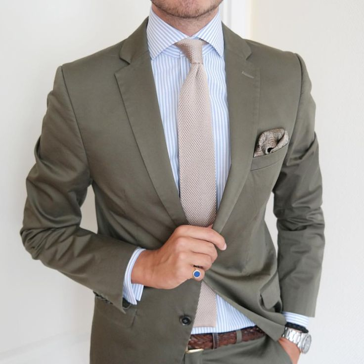 A great spring combo for men! Olive green suit, blue striped shirt, cream knit necktie