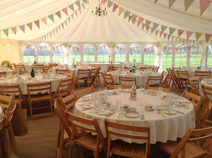 Gorgeous wedding marquee with bunting adding the finishing touch ...