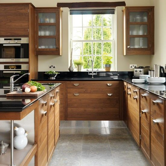 Take a tour around a smart walnut kitchen beautiful for Beautiful kitchen units designs