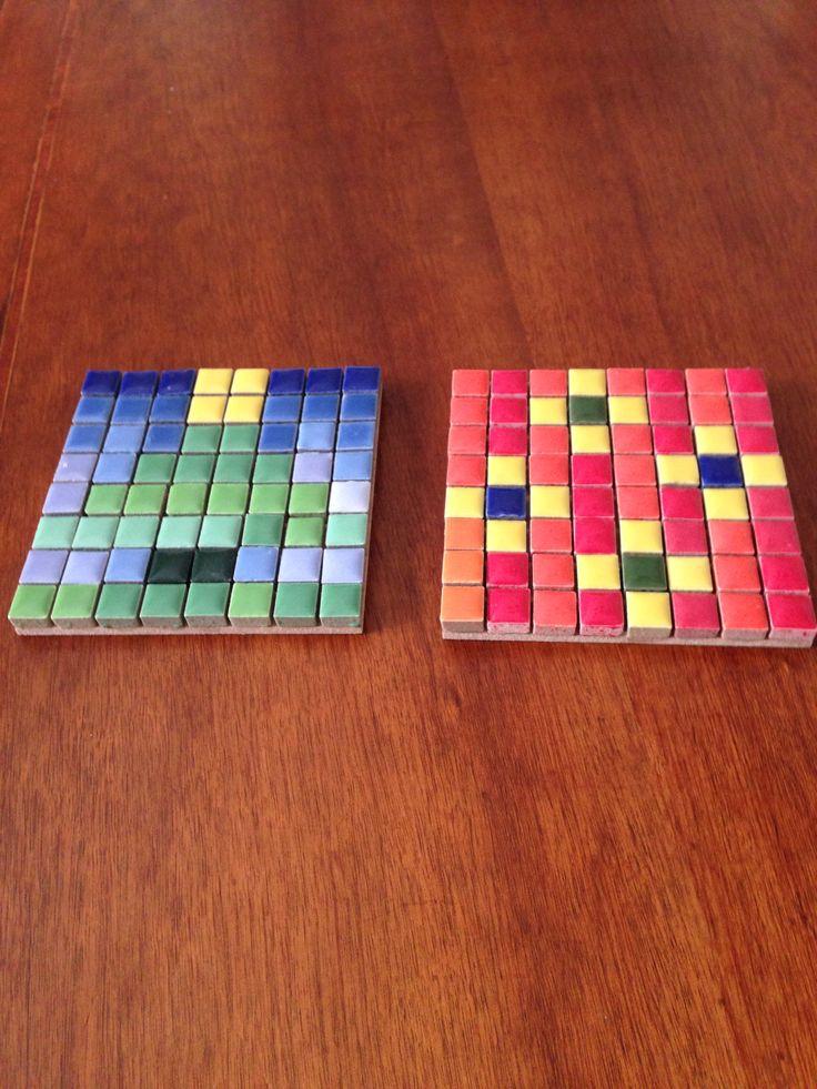 Proyecto diseñado por mis niños (10 y 8 años) como regalo de fin de año para sus profesoras. Pegados con ayuda de mamá! Teselas de cerámica, cola fría y cuadrados de trupán de Homecenter.