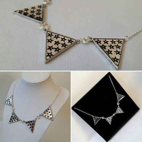 This star necklace is simple yet beautiful. The bunting pendants are made with black shiny stars set in resin within a silver plated bezel pendant. The pendants are 1 inch (2.5 cms) wide and 1 inch (2.5 cms) high. The chain can be made any length you need.   *Its easy to make this necklace all yours, just click Add to Cart and it will be with you soon!*   PLEASE READ ON FOR MORE INFO about this item and the Jewellsy shop: ★ Handmade in the UK. ★ In Stock and Ready to Ship now! ★ Shipped…