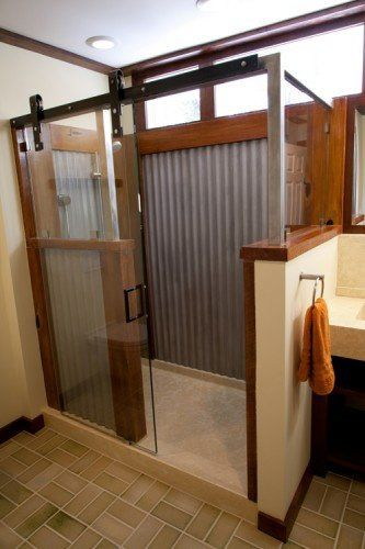walk in shower with a barn door | rustic shower. Corrugated galvanized steel, wood, barn door hardware