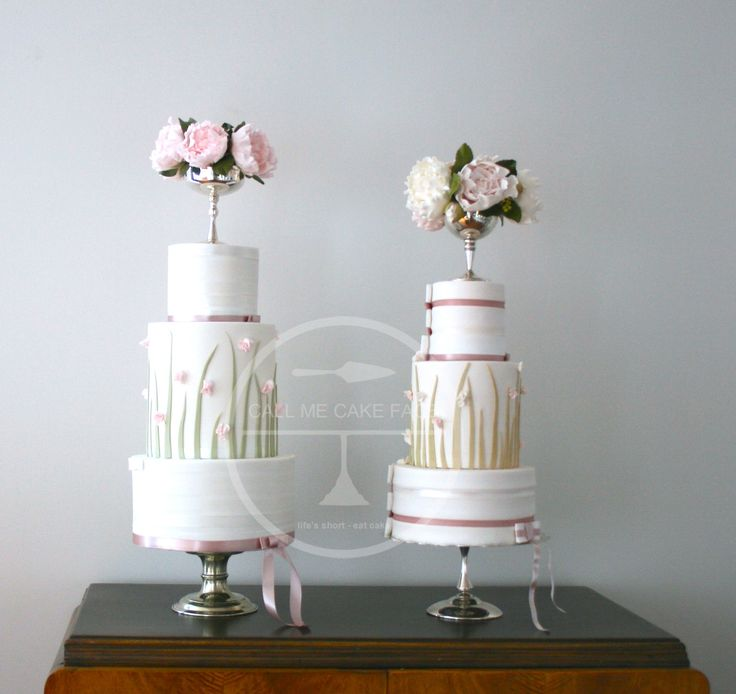 Garden inspired fondant detail and banded satin ribbon.  Top tier adorned with a silver goblet of sugar peonies and sugar leaves.