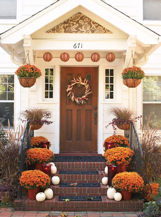 Simple craftsman entry with bracket portico, deck out for a happy Thanksgiving.