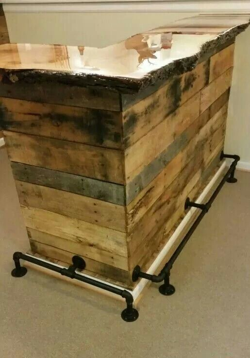 Love this DIY bar! Sealed reclaimed wood bar top, wide planks on the front, galvanized pipes for foot rails
