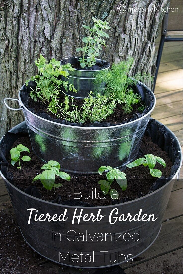 Purple-black thumb like me? Get your gardening newbie feet wet and Build a Simple Tiered Herb Garden in Galvanized Tubs for a shabby-vintage-farm-chic vibe and farm-fresh seasonings!