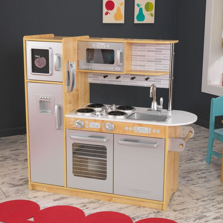 It's time to cook up a little fun, with the Uptown Natural Kitchen. Designed with a modern look that young chefs are sure to love, this wooden kitchen is full of fun details like a cordless phone and a chalkboard for writing the daily specials.
