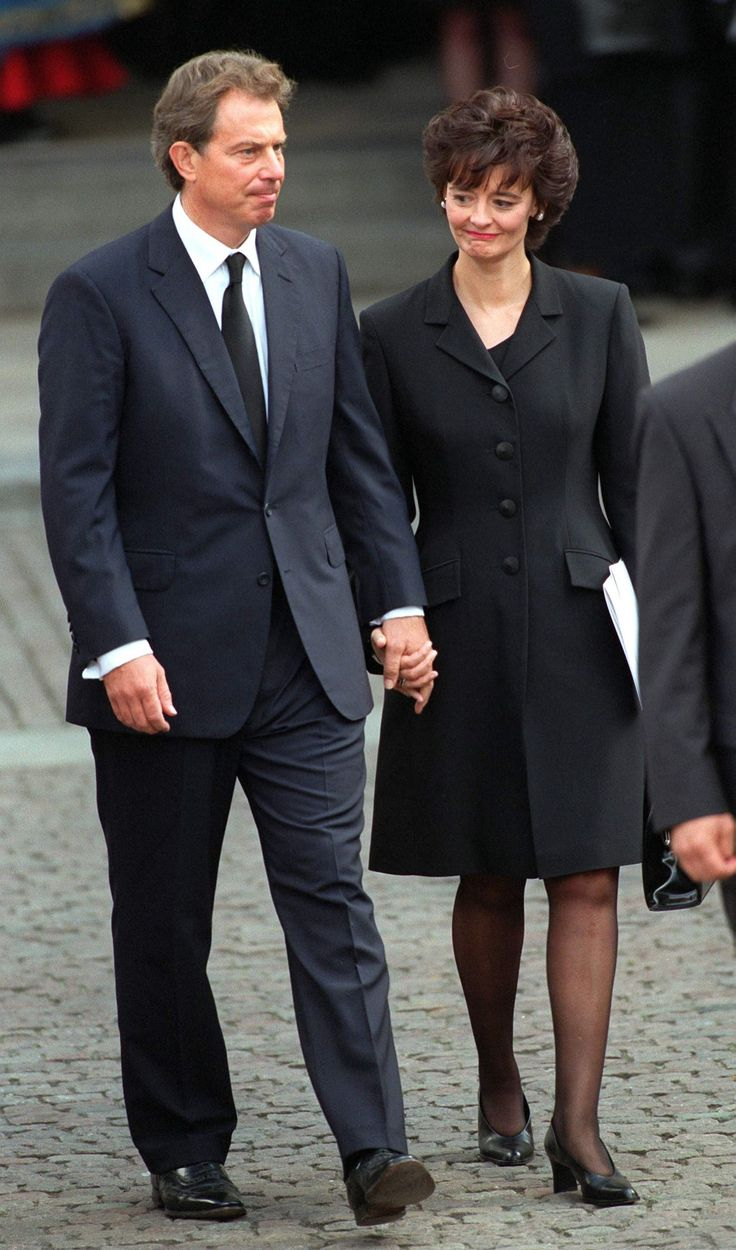 Then-Prime Minister Tony Blair and his Wife Cherie outside the service. - TownandCountrymag.com