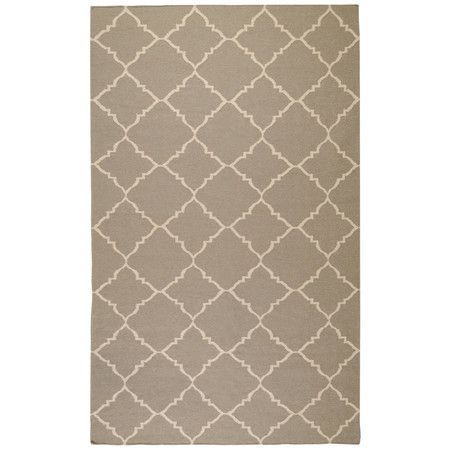 Flatweave wool rug with a trellis motif. Handmade in India.    Product: RugConstruction Material: 100% Wool