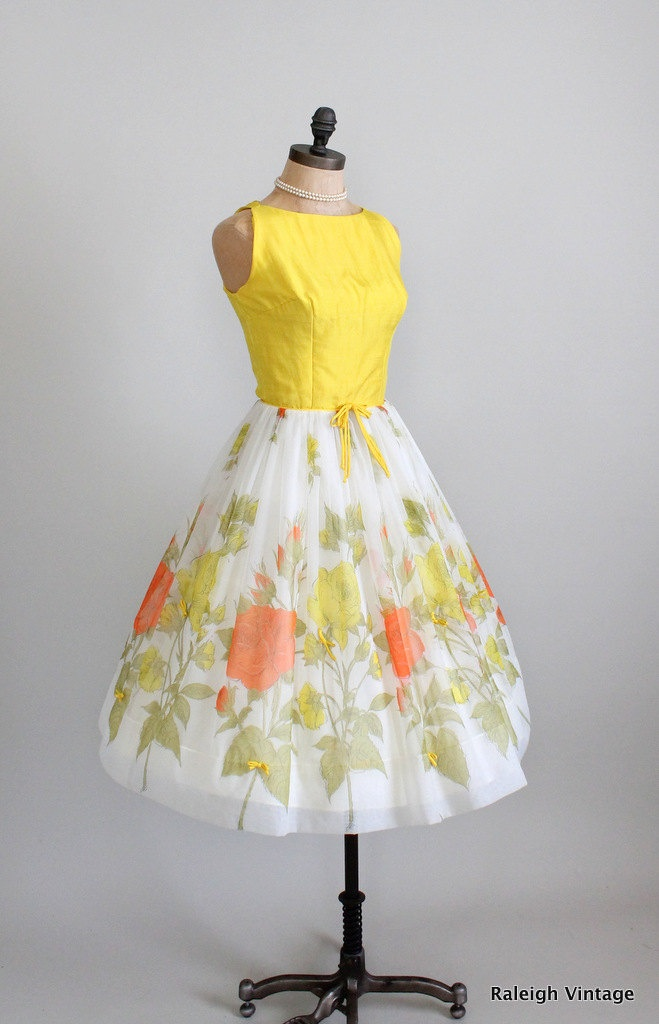 Vintage 1960's daytime dress. Reflects the styles of the 1960's with the bright colors, the new look fullness of the skirt and the sleeveless top.