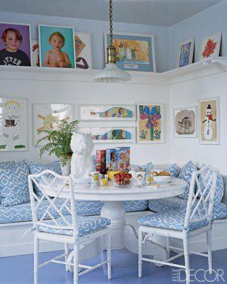 Aerin Lauder's manhattan kitchen nook.  Children's artwork + quadrille upholstery