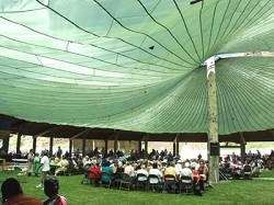<I>Chuck Anderson/Chieftain</I><BR>Under the big canopy at the Nez Perce Homeland Project site, Nez Perce and non-Indians enjoy the Friendship Feast on Sunday, July 18, a highlight of the Tamkaliks Celebration.