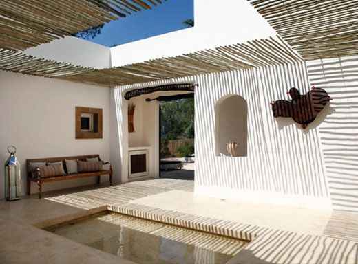 white wash walls outside kitchen, include bench and display nooks Summer House on Formentera