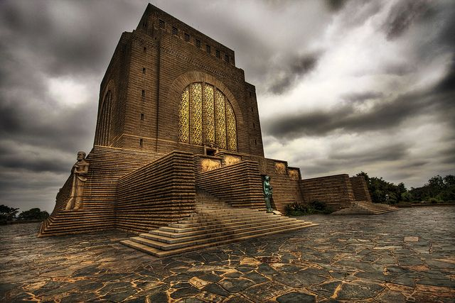 "The Voortrekker Monument is a monument in the city of Pretoria, South Africa. The massive granite structure, built to honour the Voortrekkers who left the Cape Colony between 1835 and 1854, was designed by the architect Gerard Moerdijk who had the idea to design a ""monument that would stand a thousand years to describe the history and the meaning of the Great Trek to its descendants"". It can be seen from almost any location in the city, as it is seated on a hilltop."