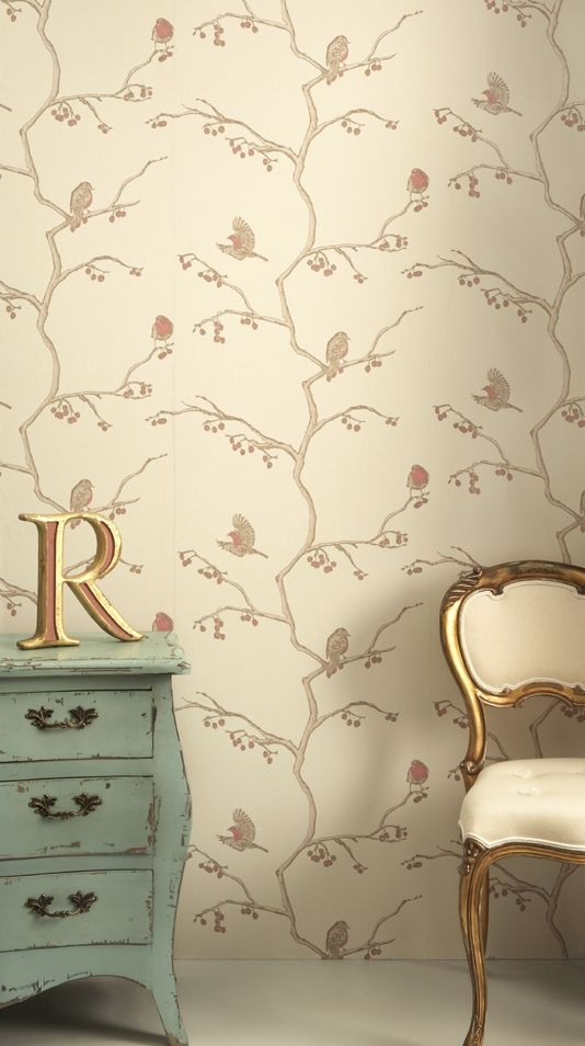 The English Robin Wallpaper, a cream wallpaper with robins sitting on, or flying off branches. A timeless design!