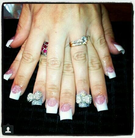 Nails by Katelyn. Euphoria Salon. Gulf Breeze, FL. Sparkly. Bling. Bows. Pink and white. Acrylic. Glitter. Fancy. Fun.