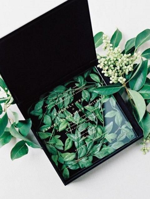 artistic invitations with acryl and leaves inside the box