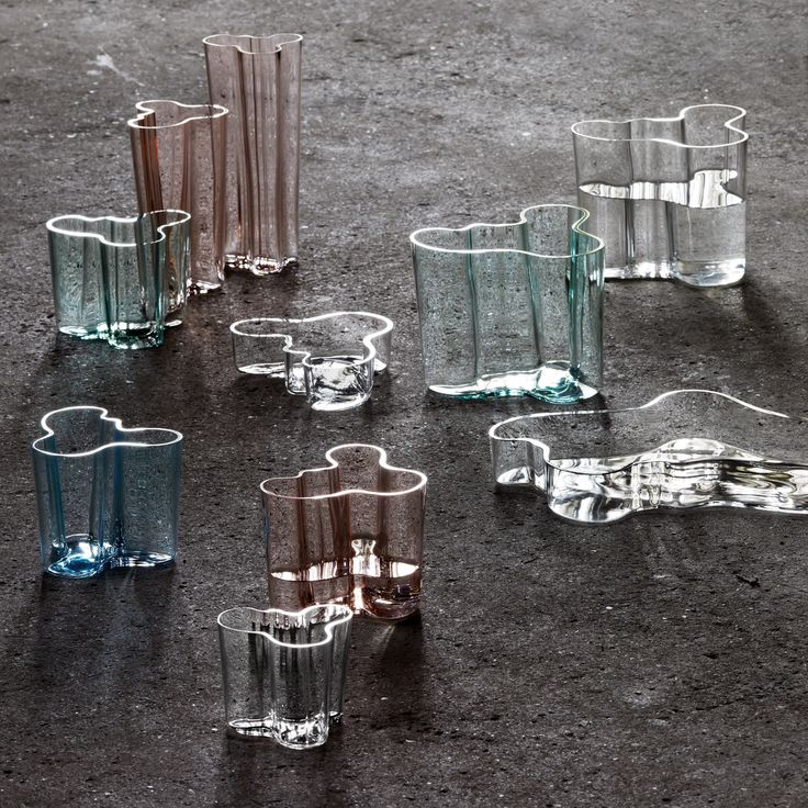 The Aalto vase in the colors rain and clear. Aalto wanted the design made from everyday glass, not lead crystal, so the early vases used glass available in the factory at that time. Since the 1960s more colors have been added.