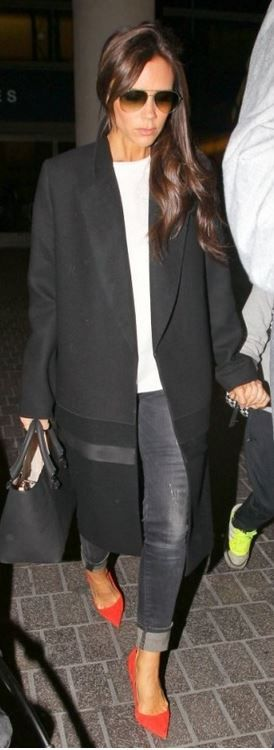 Who made  Victoria Beckham's black coat, black handbag, red suede pumps, and aviator sunglasses that she wore at LAX airport?