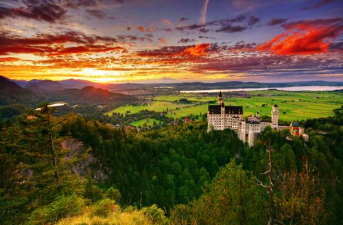 Neuschwanstein Castle, Bavaria, Germany~The municipality of Schwangau lies at an elevation of 800 m (2,620 ft) at the south west border of the German state of Bavaria. Its surroundings are characterized by the transition between the Alpine foothills in the south (towards the nearby Austrian border) and a hilly landscape in the north that appears flat by comparison.