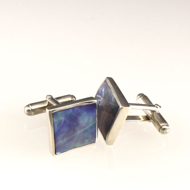 Paua Jewelry: Rens Tasman Cufflink Price: $249.00 USD available on the Wild Jewels website:  http://wildjewels.net/product/rens-tasman-cufflink/  Our most popular paua cuff links. Simply elegant and beautifully matched with multi colored shirts.