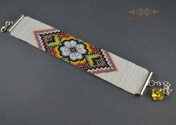 Flower pattern on the hands bracelet loom by SzkatulkaAmiJewelry