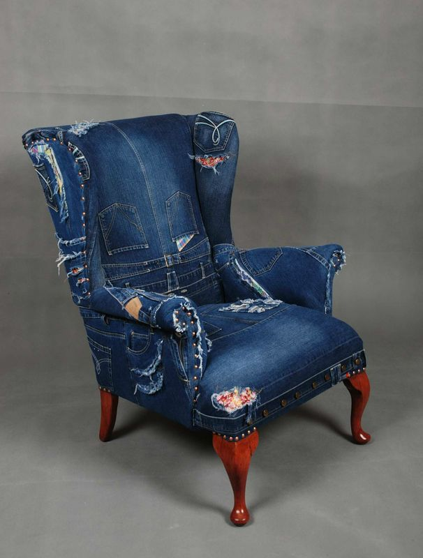 This would be amazing in an otherwise posh living room or study.  Denim wingback chair.