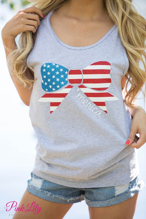 You're going to love wearing this patriotic tank all summer long - and especially on the Fourth of July! Featuring the stars and stripes in red glitter, blue glitter, and white vinyl, we took this already lovely color scheme and incorporated it into a bow! The finishing touch is the 'Merica in white vinyl lettering. Just add a pair of shorts and sandals to complete your look before starting up the grill!