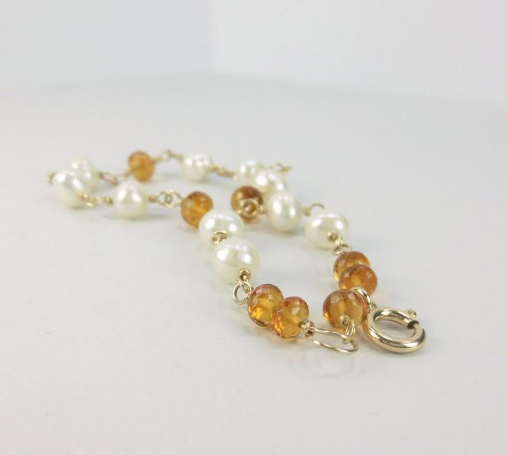 Pearl and Citrine Wire Wrapped Link Bracelet, 14K Gold Filled, Nickel Free, June and November Birthstone. $54 http://www.healingcrystaljewelry.ca/collections/gemstone-bracelets/products/pearl-and-citrine-wire-wrapped-link-bracelet-14k-gold-filled-nickel-free-june-and-october-birthstone