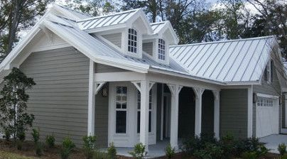 Grey house with grey standing seam roof and white trim - all it needs is the black shutters!