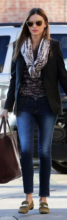 Who made Miranda Kerr's cat sunglasses, skinny blue jeans, tote handbag, green suede loafers, print scarf, black blazer, and print top that she wore in Los Angeles on January 4, 2012?