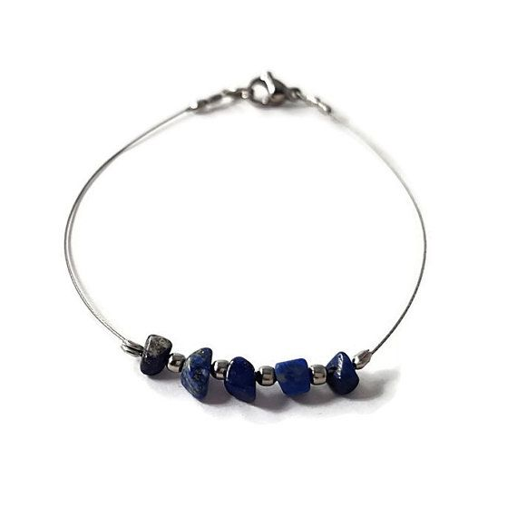 "✿ In the ""Shiny"" #Jewelry, you will find #dainty #silver #bracelet adorned with #Lapis #Lazuli (#natural #gemstone) and #silvery #beads. This delicate bracelet is #handmade with natural #LapisLazuli chips and #stainless #steel beads on silver wired steel  ☯ Lapis Lazuli is a stone of friendship and brings harmony in relationships.  #etsy #etsyjewelry #etsyfinds #etsylove #etsyshop  https://www.etsy.com/listing/454642760/natural-stone-bracelet-lapis-lazuli"